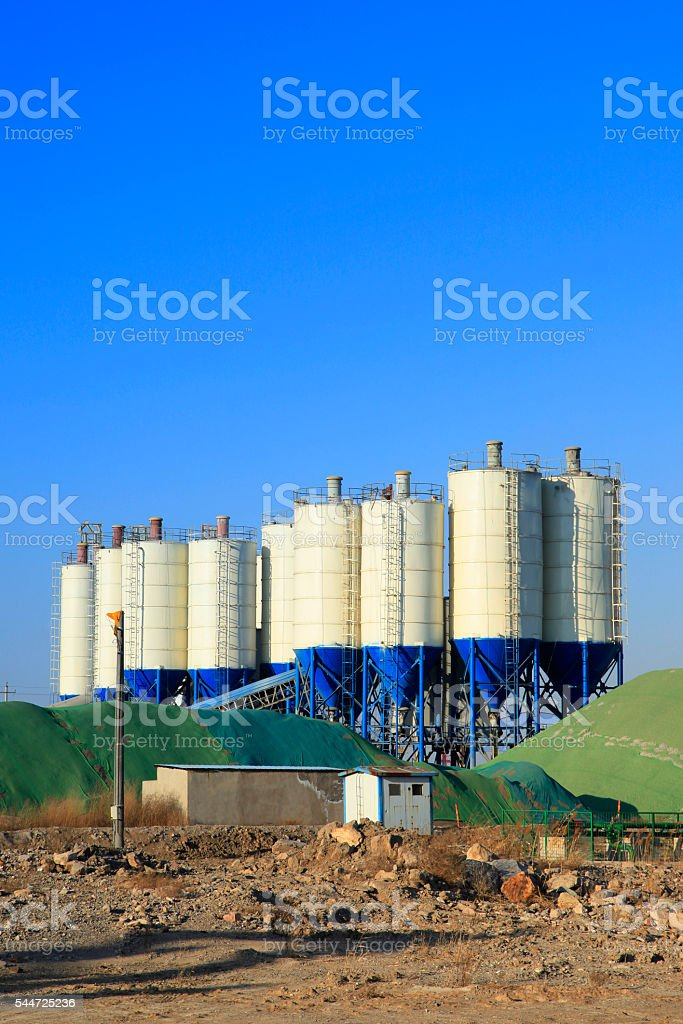 Concrete mixing tower. Concept of on-site construction facility. stock photo