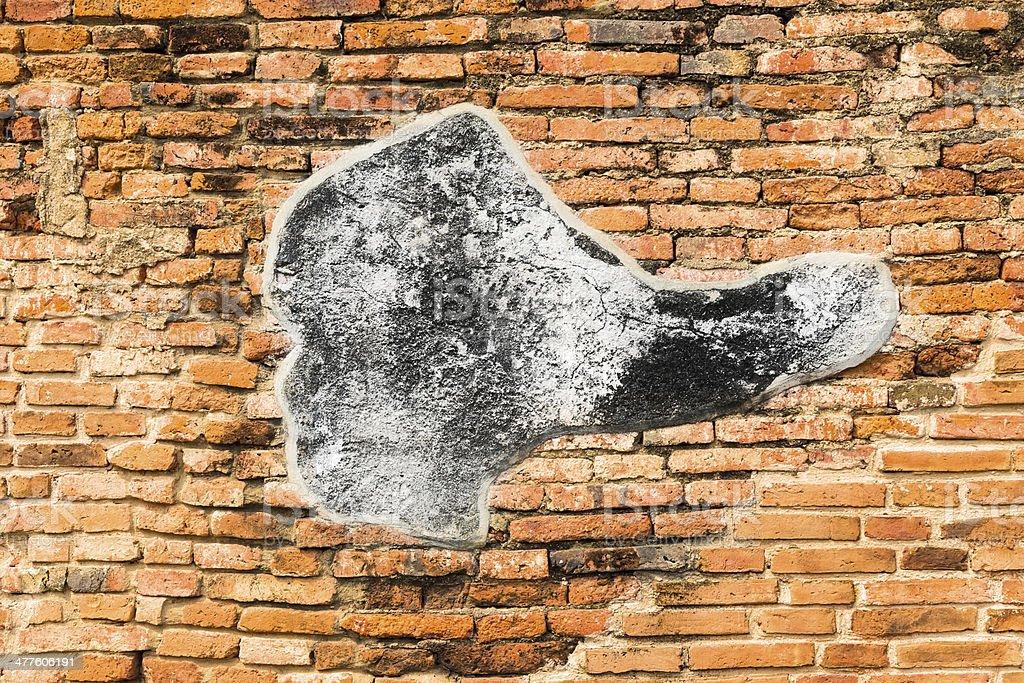 Concrete on cracked bricks wall royalty-free stock photo