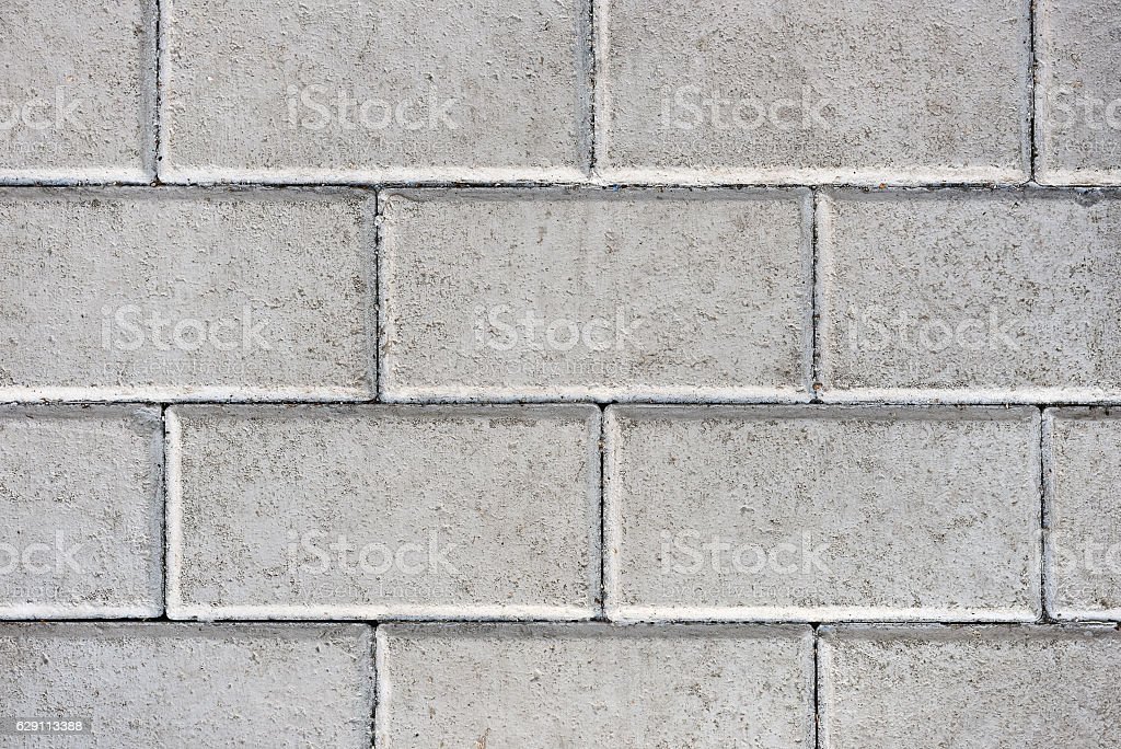 Concrete or cobble gray pavement slabs or stones. stock photo