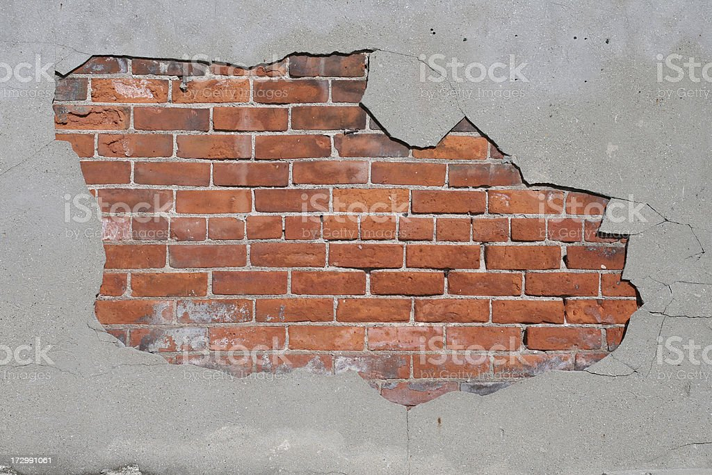 Concrete overlay gives way to brick stock photo