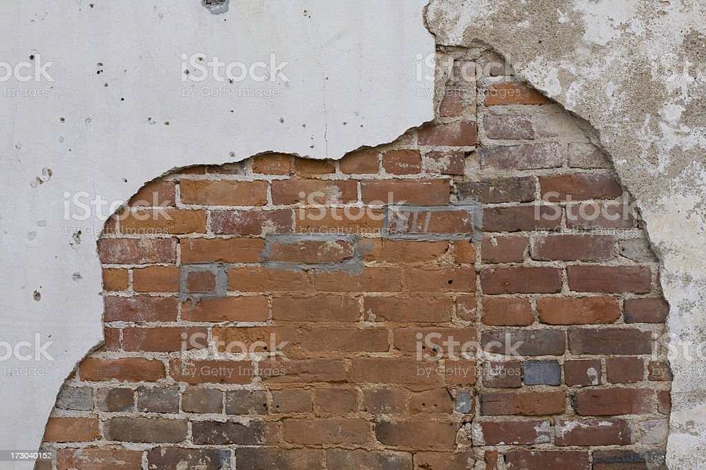 Concrete overlay giving way to brick royalty-free stock photo