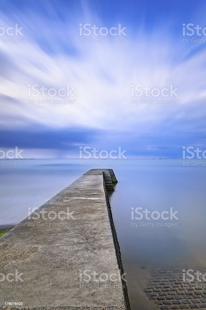 Concrete pier or jetty on a blue sea. Normandy, France royalty-free stock photo