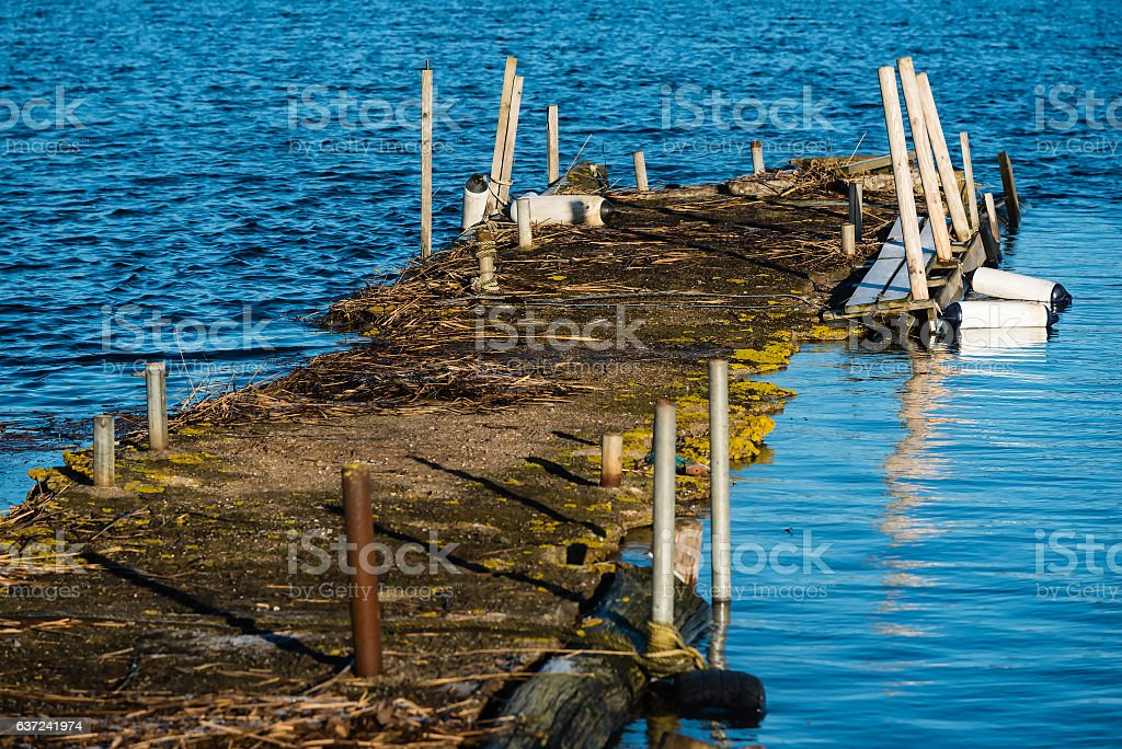 Concrete pier with poles stock photo