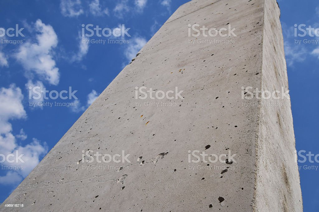 Concrete pillars against cloudy blue sky royalty-free stock photo