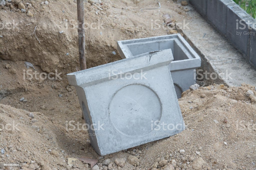 Concrete pipe stacked sewage water system aligned on site. stock photo