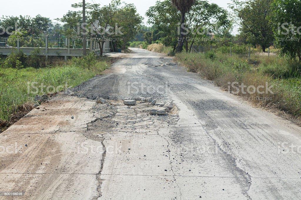 concrete road broken stock photo