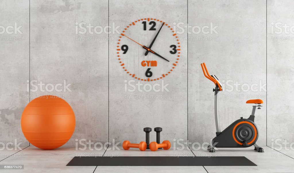 Concrete room with gym equipment stock photo