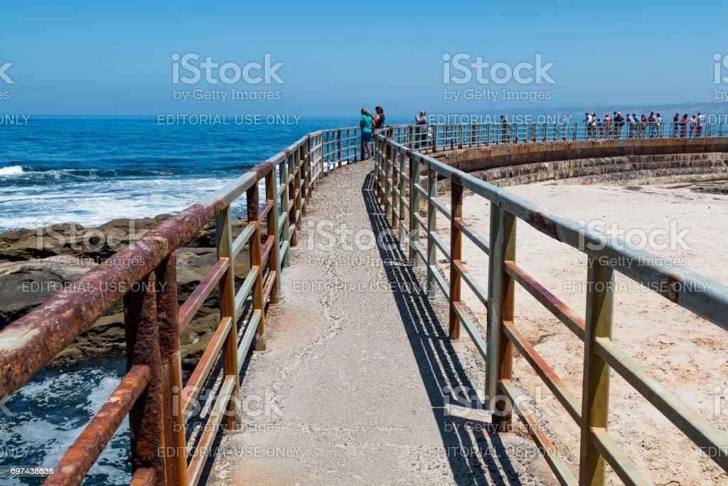 Concrete Sea Wall with Railing at La Jolla Children's Pool stock photo
