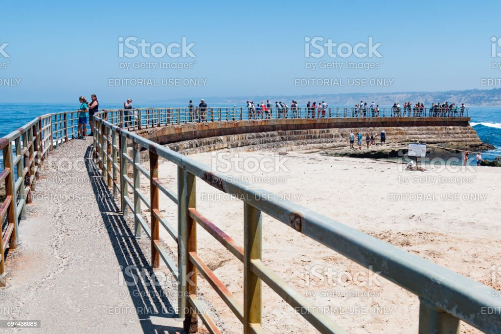 Concrete SeaWall with Metal Railing Overlooking La Jolla Children's Pool stock photo