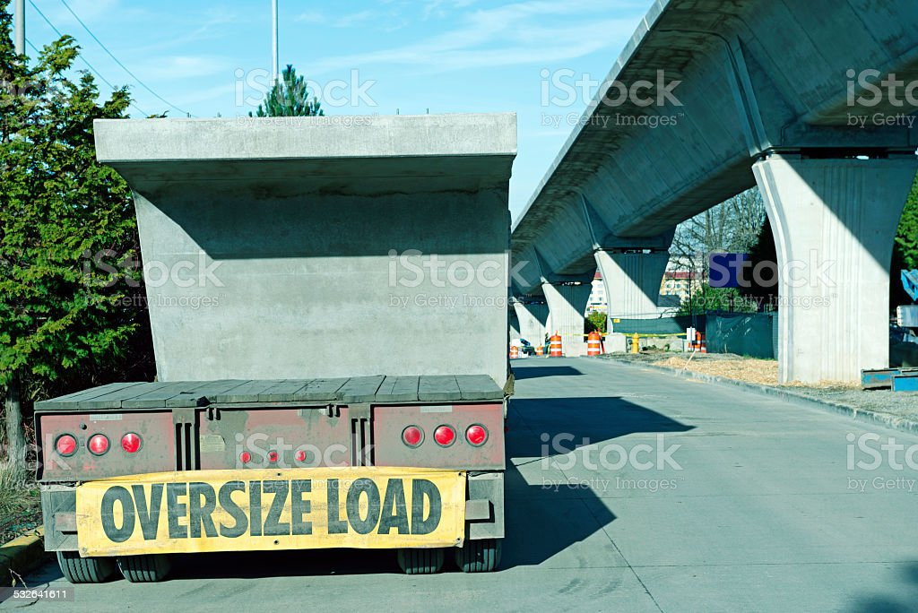 Concrete section of light rail structure on truck in Seattle stock photo
