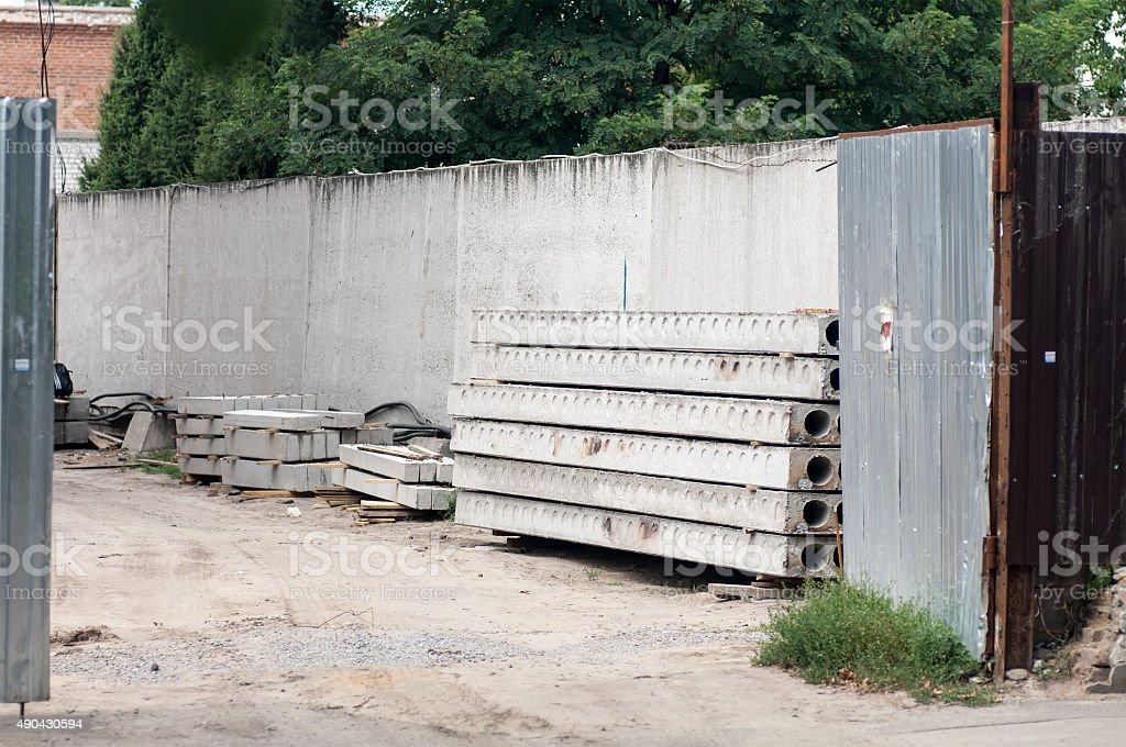 concrete slabs outside the gates of the construction site stock photo