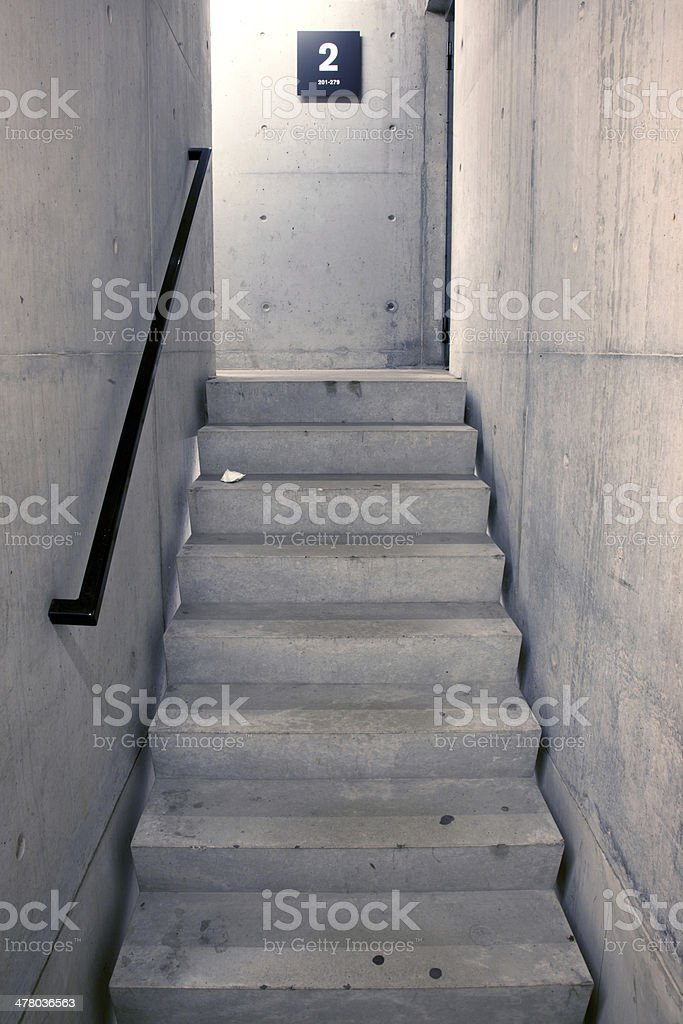 concrete staircase and stairs leading upwards to second floor royalty-free stock photo