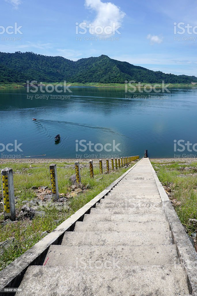 Concrete staircase in to the water stock photo
