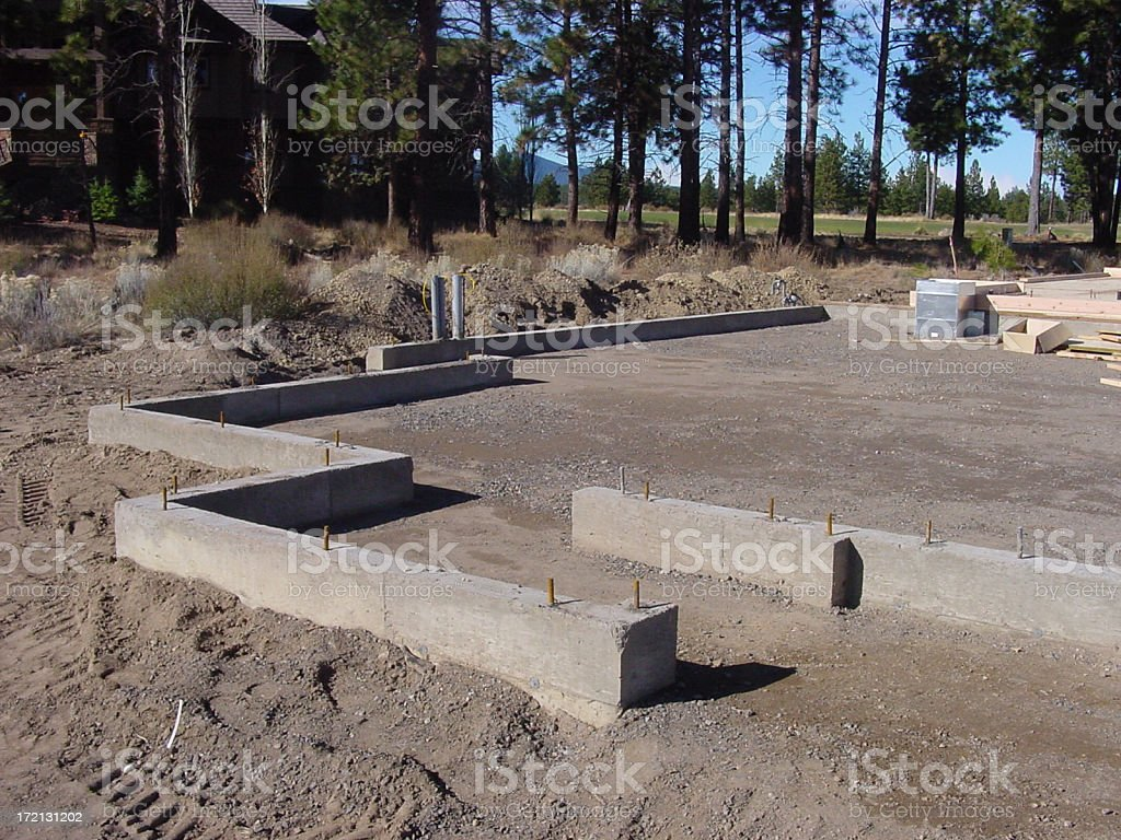 Concrete stemwall and compacted fill stock photo