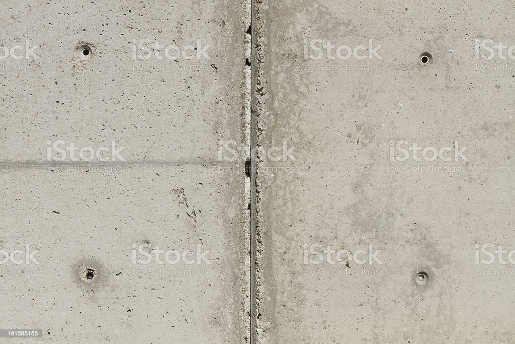 Concrete surface with four squared boreholes and chasm stock photo