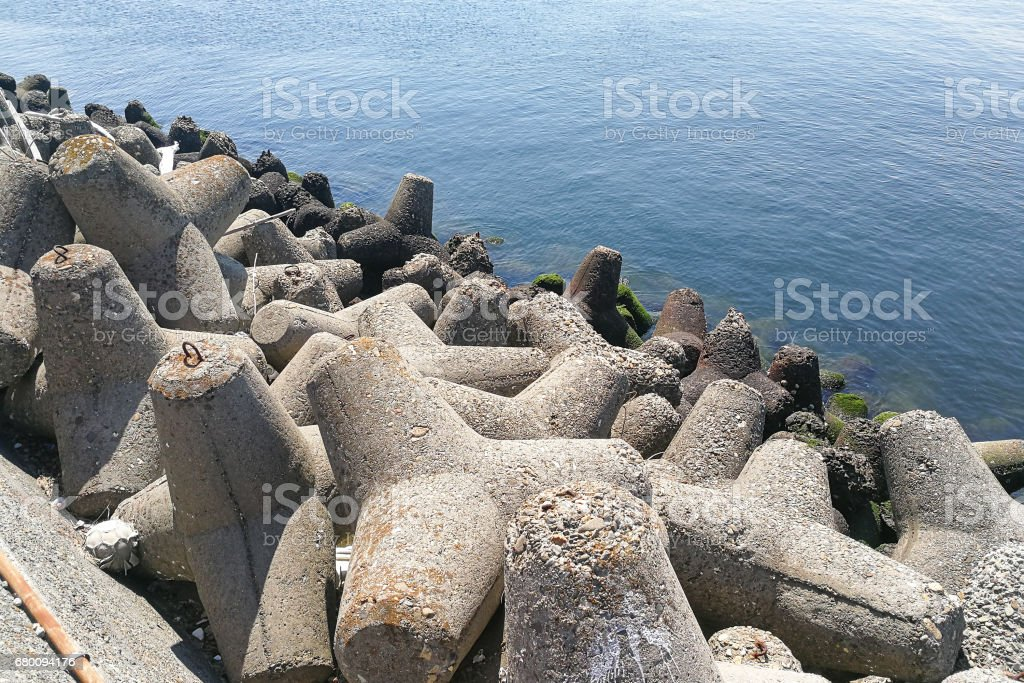 Concrete tetrapod at coast line to prevent erosion and protection stock photo