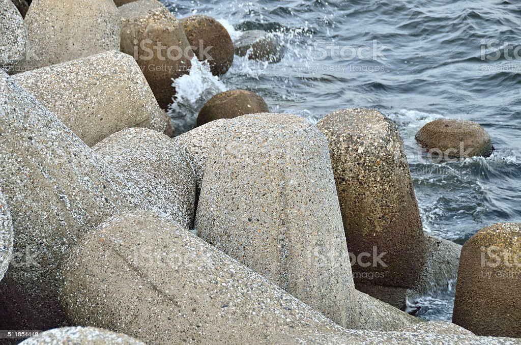 Concrete tetrapods at the sea coast stock photo