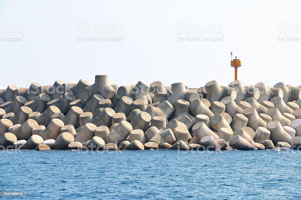 Concrete tetrapods make up a breakwater in South Korea. stock photo