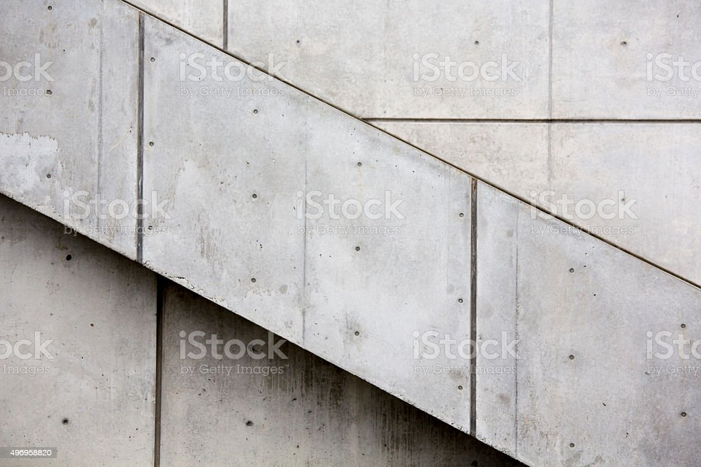 Concrete wall and stairwell at an angle as background stock photo