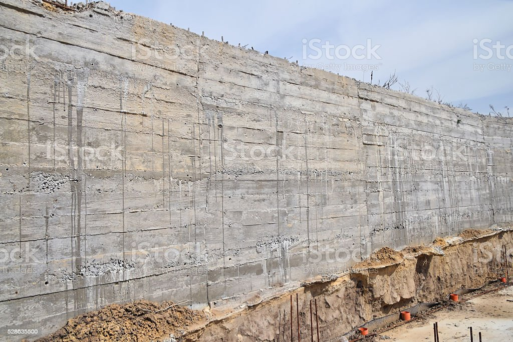 Concrete wall at construction site stock photo