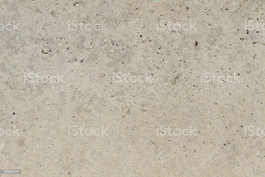 Concrete wall closeup with holes and crackles royalty-free stock photo
