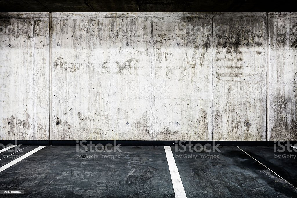 Concrete wall underground garage interior background texture stock photo
