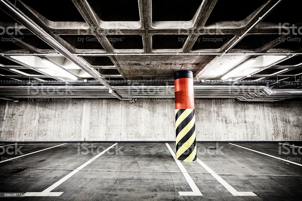 Concrete wall underground parking garage interior stock photo
