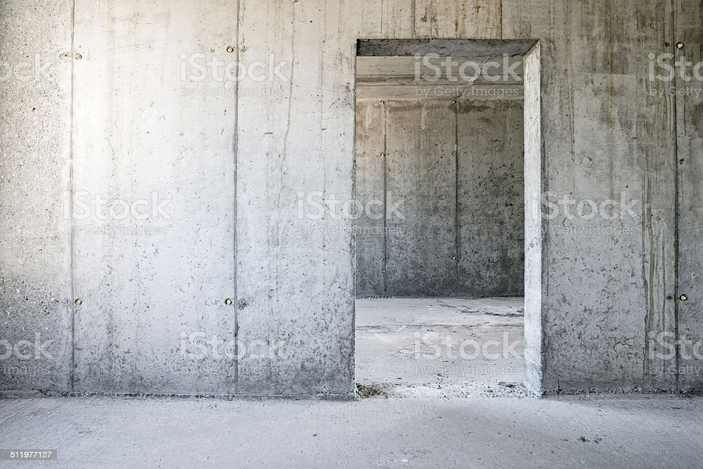 Concrete wall with door-frame, concrete ceiling, floor, new building stock photo