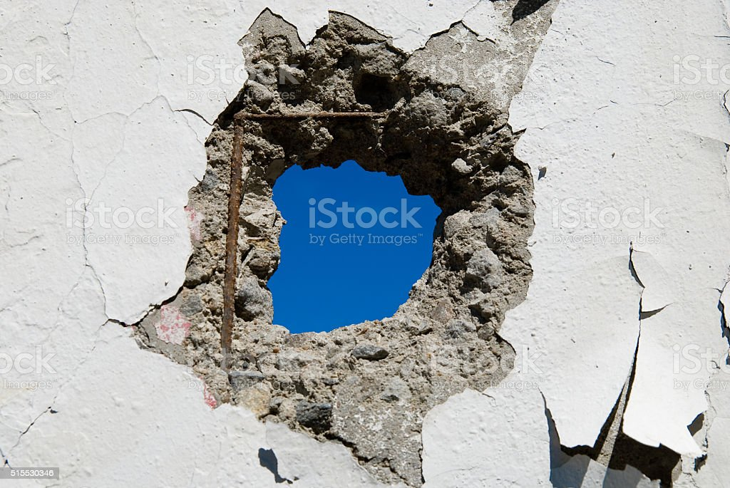 Concrete wall with holes stock photo
