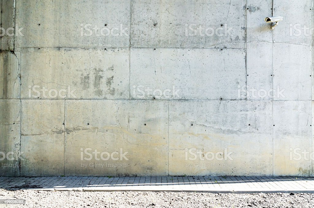 Concrete wall with monitoring camera on it stock photo
