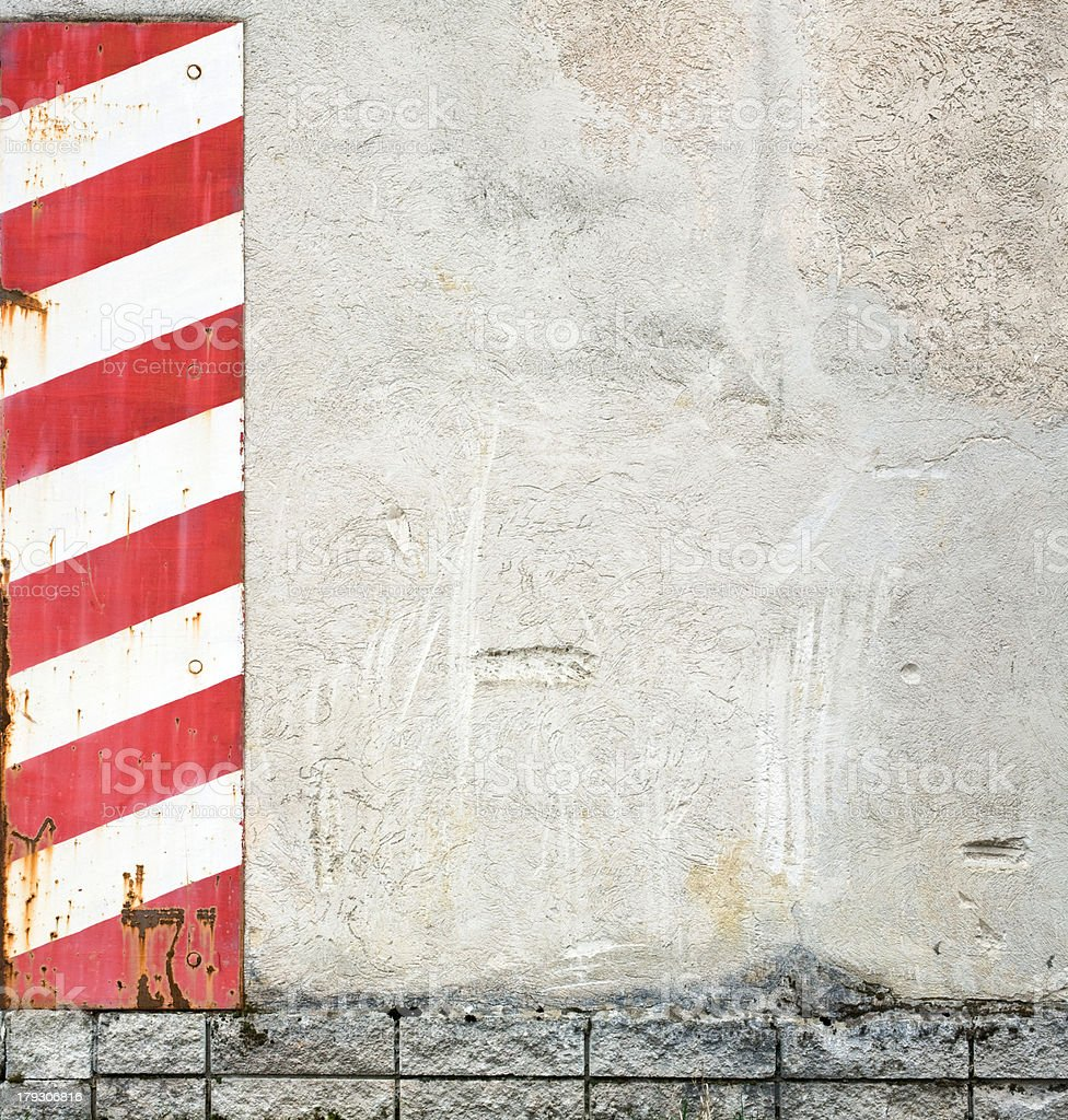 concrete wall with red warning stripes royalty-free stock photo