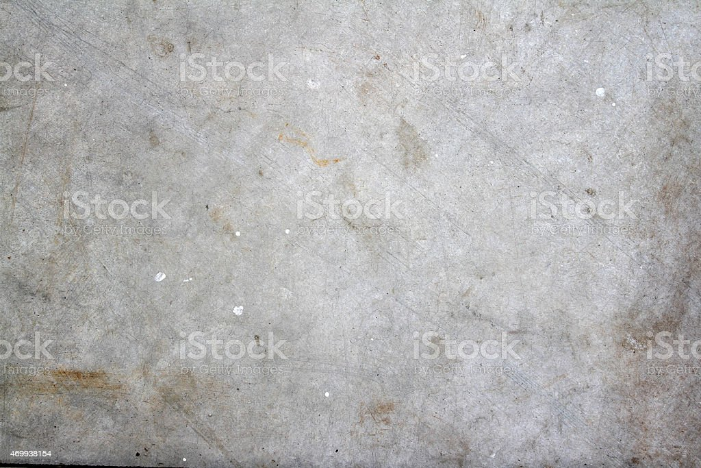 Concrete wall with smears and scratches stock photo
