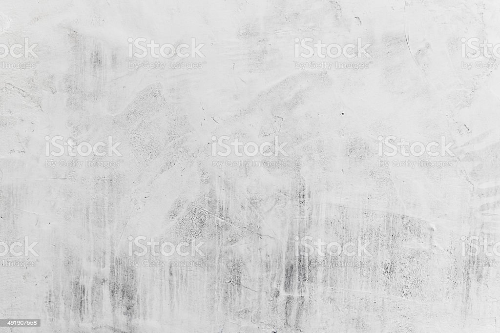 Concrete wall with whitewash layer, background stock photo