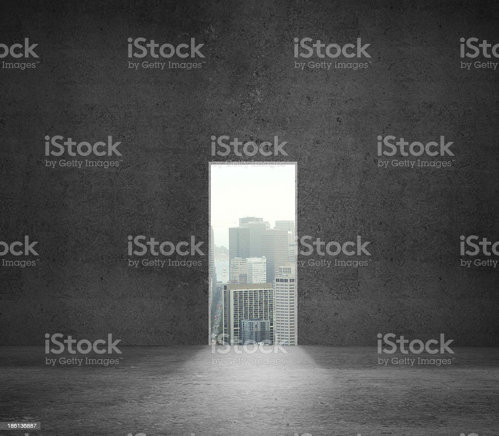 Concrete wall with window cut out, looking over the city royalty-free stock photo
