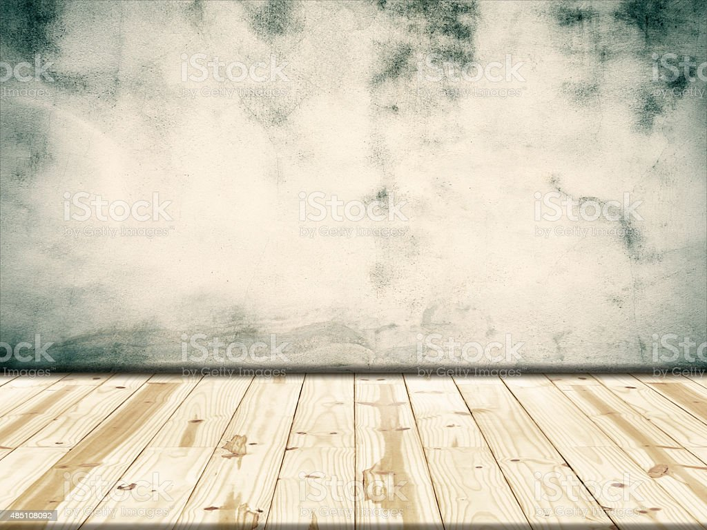Concrete walls and wooden floor background royalty-free stock photo