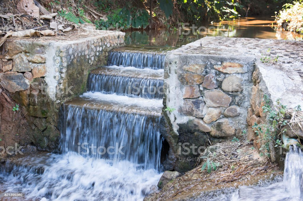 Concrete weir at stream.Ladder weir background stock photo