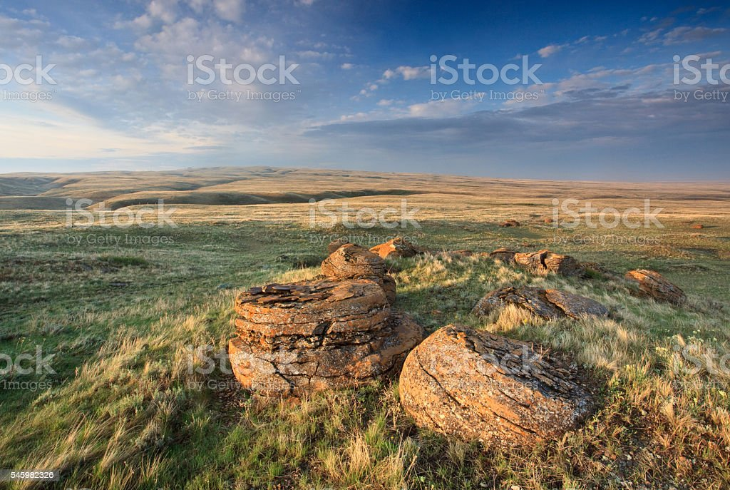 Concretions at Red Rock Coulee With Beautiful Prairie Sky stock photo