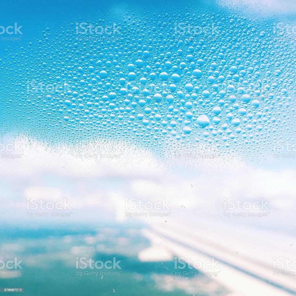 Condensate on airplane window stock photo