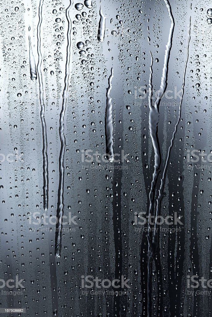 Condensation on a window in the shadows royalty-free stock photo