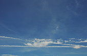 condensation trail from jet plane on sky