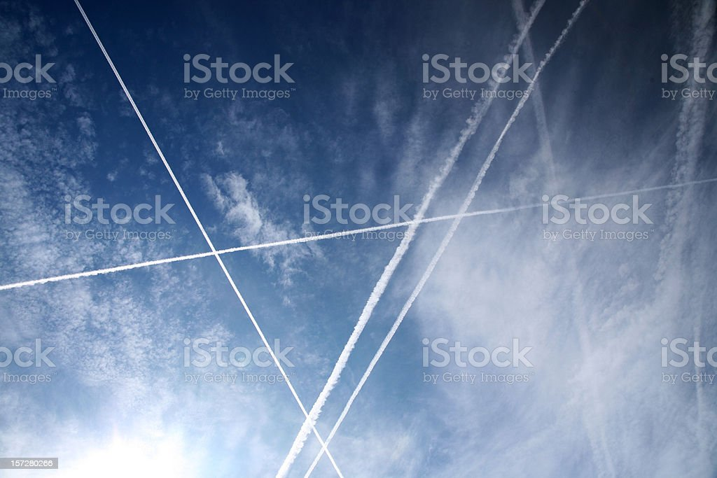 Condensation trails in the sky royalty-free stock photo