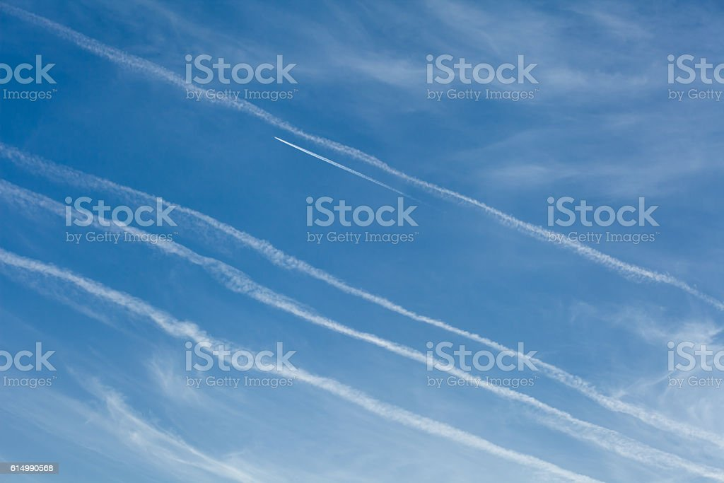 condensed traces of planes in the sky stock photo