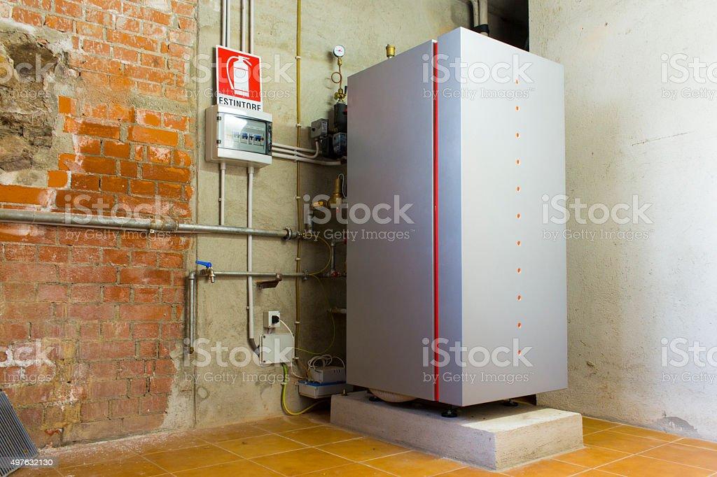 Condensing gas boiler in the boiler room stock photo