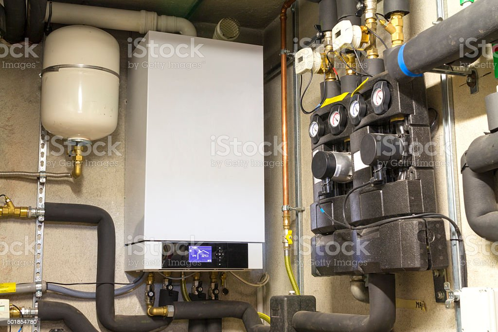 Condensing gas boiler in the boiler room stock photo