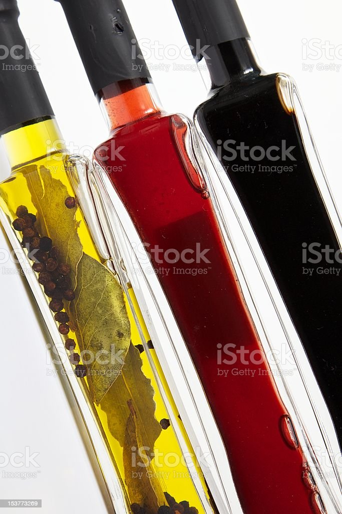 Condiment Bottles, Oil and Vinegar, oblique royalty-free stock photo