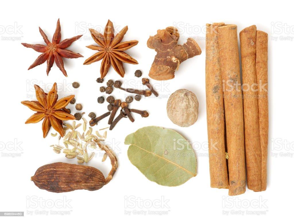 Condiment set,Cinnamon, black cardamom and anise on white background stock photo