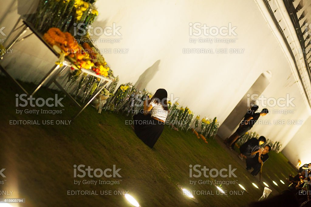 Condolence flowers and thai women at Grand Palace stock photo