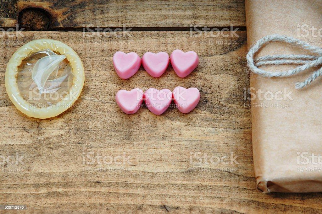 Condom, heart shapes and gift box stock photo