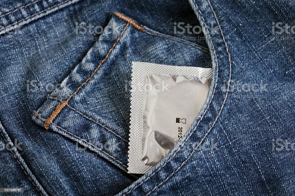 Condom in a jeans pocket royalty-free stock photo