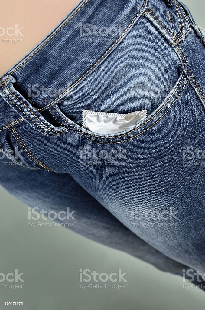 Condom in pocket royalty-free stock photo